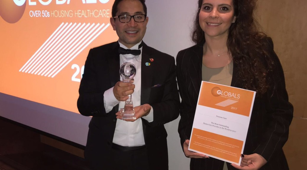 Penrose Care Managing Director Robert Stephenson-Padron and senior care worker Nikoletta Makouli following Penrose Care being named the Most Outstanding Home Care Provider in the World.